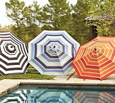 The Sunbrella Striped Umbrella ($350), positioned on an outdoor .