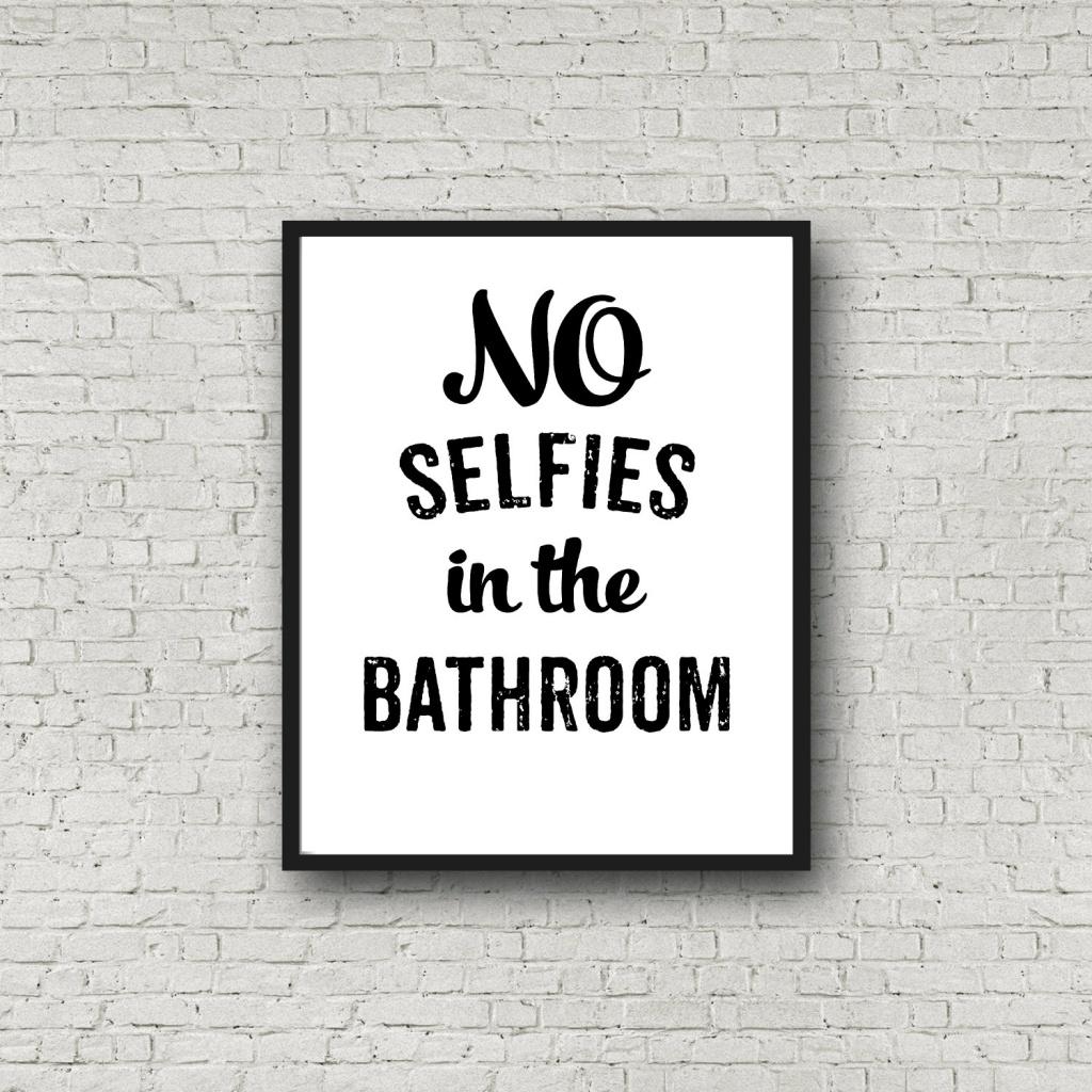 Satirical bathroom sign