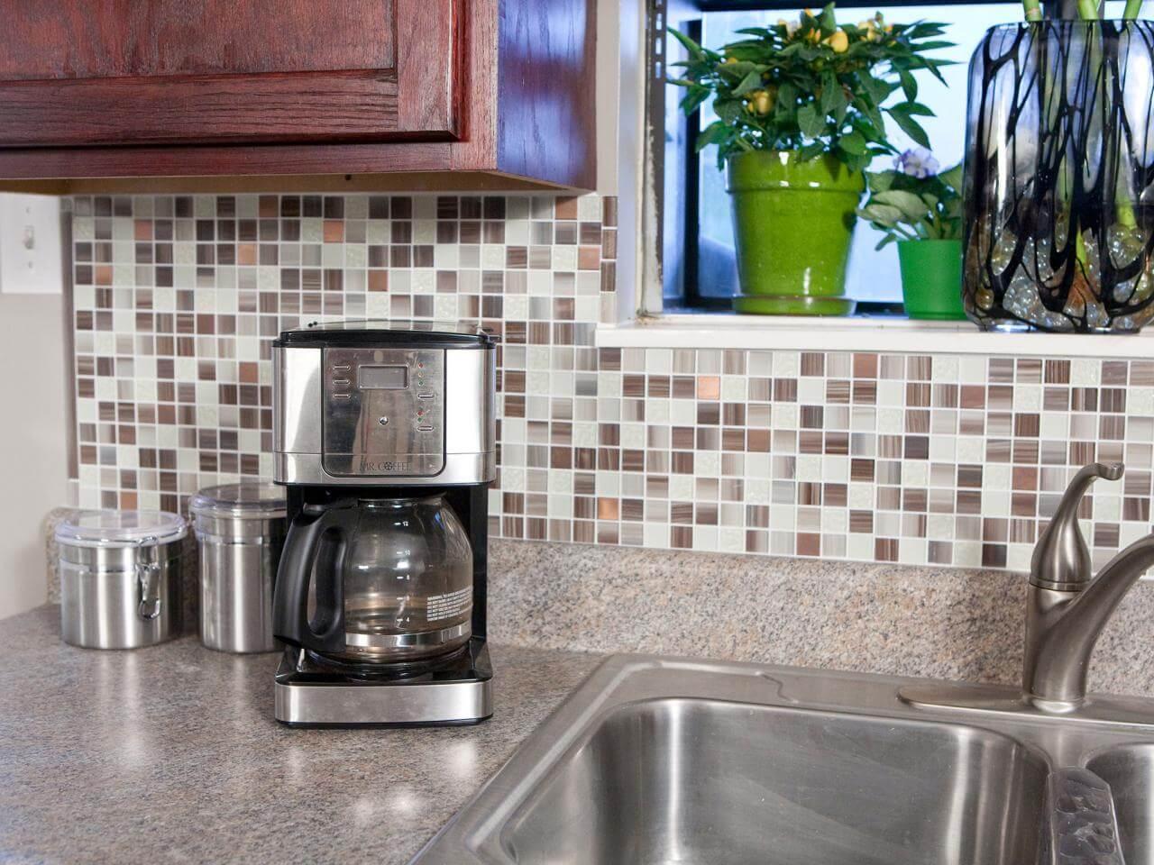 Self-adhesive tiles as a contemporary kitchen splashback
