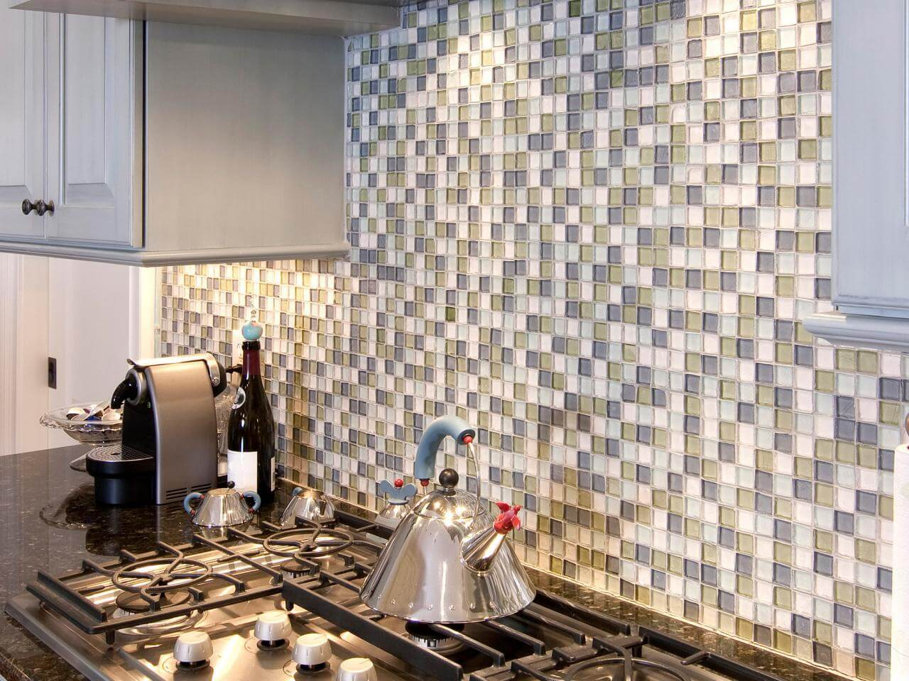 Modern kitchen back wall made of glass tiles