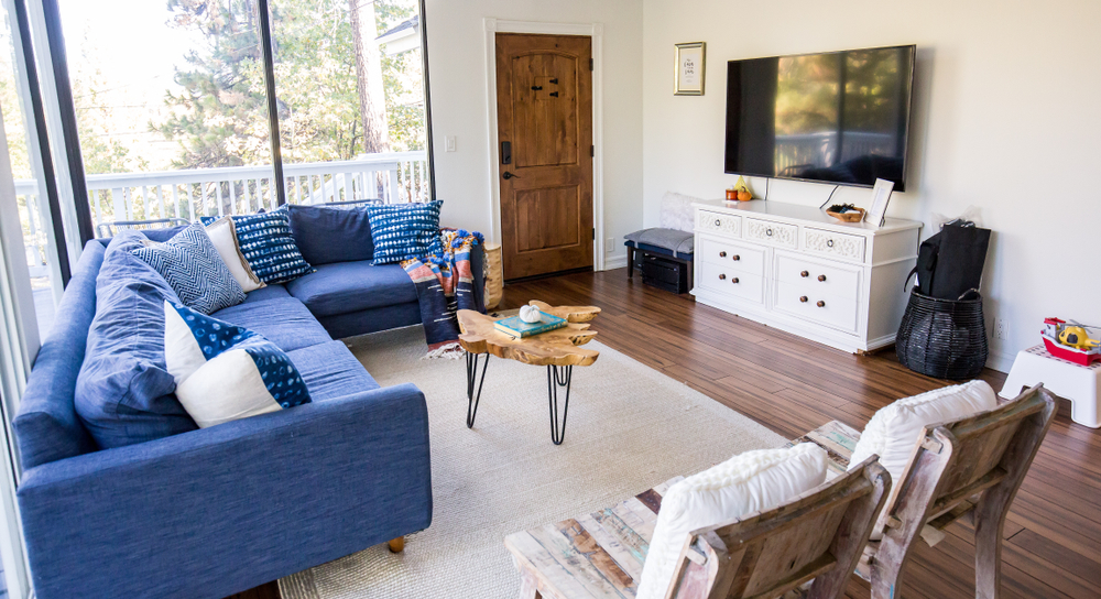 Blue sofa in living room with window pane