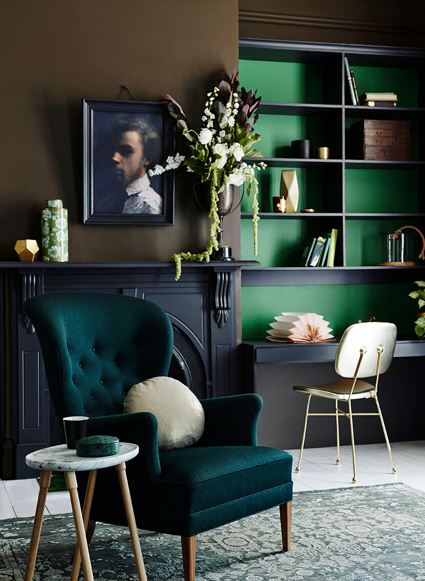 Blue-green living room with wing chair
