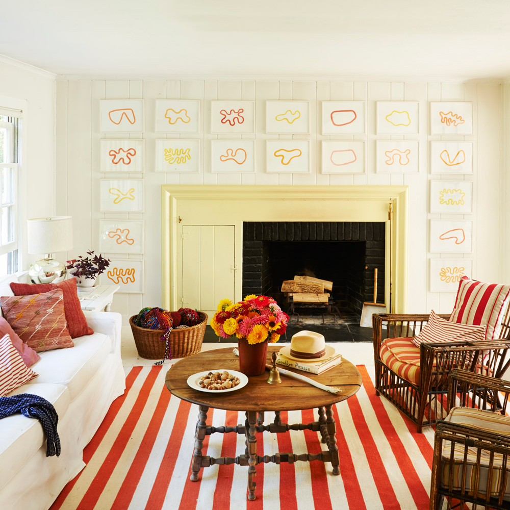 Orange living room with a beach-inspired chair