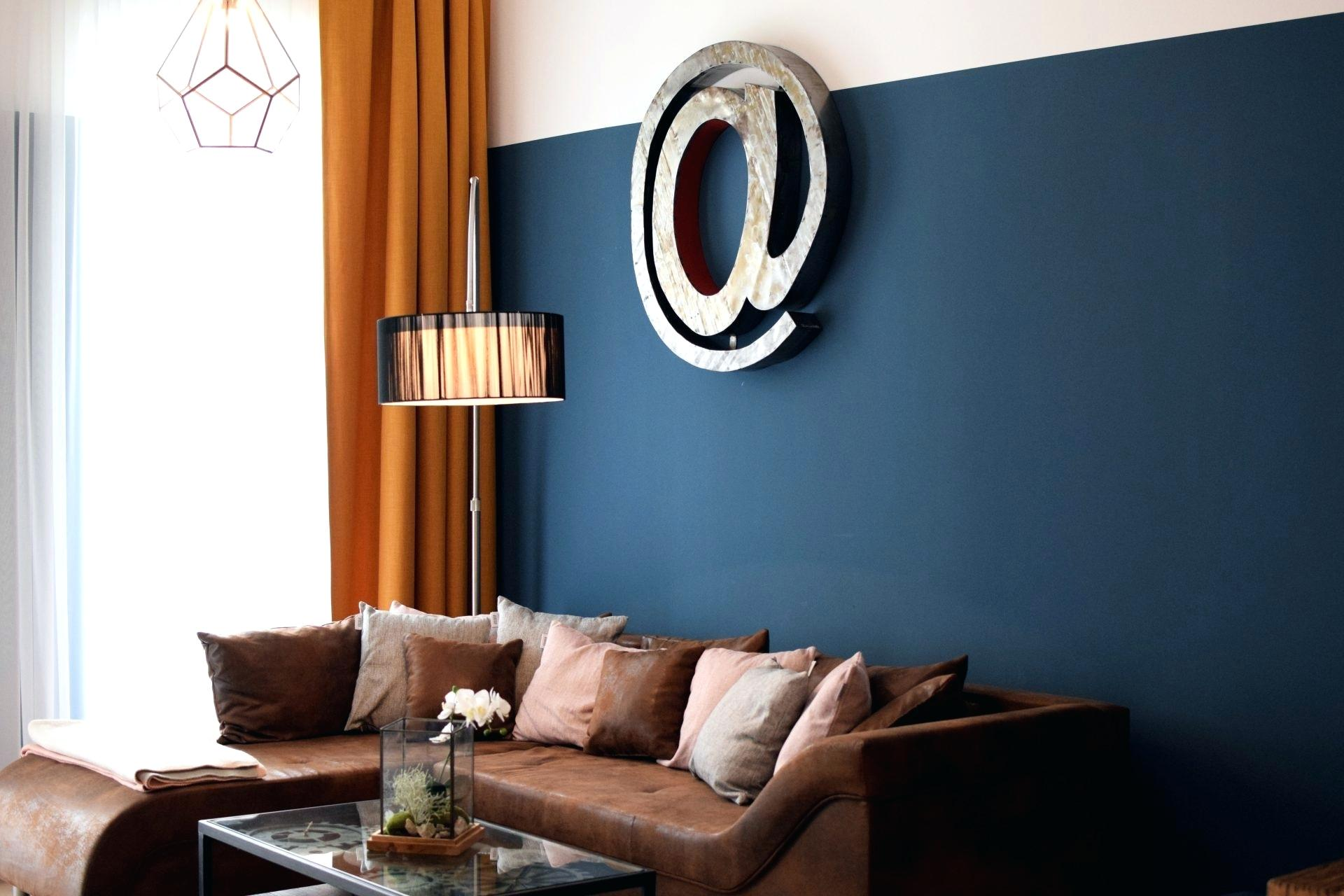 Trendy living room model in blue-green and brown brown