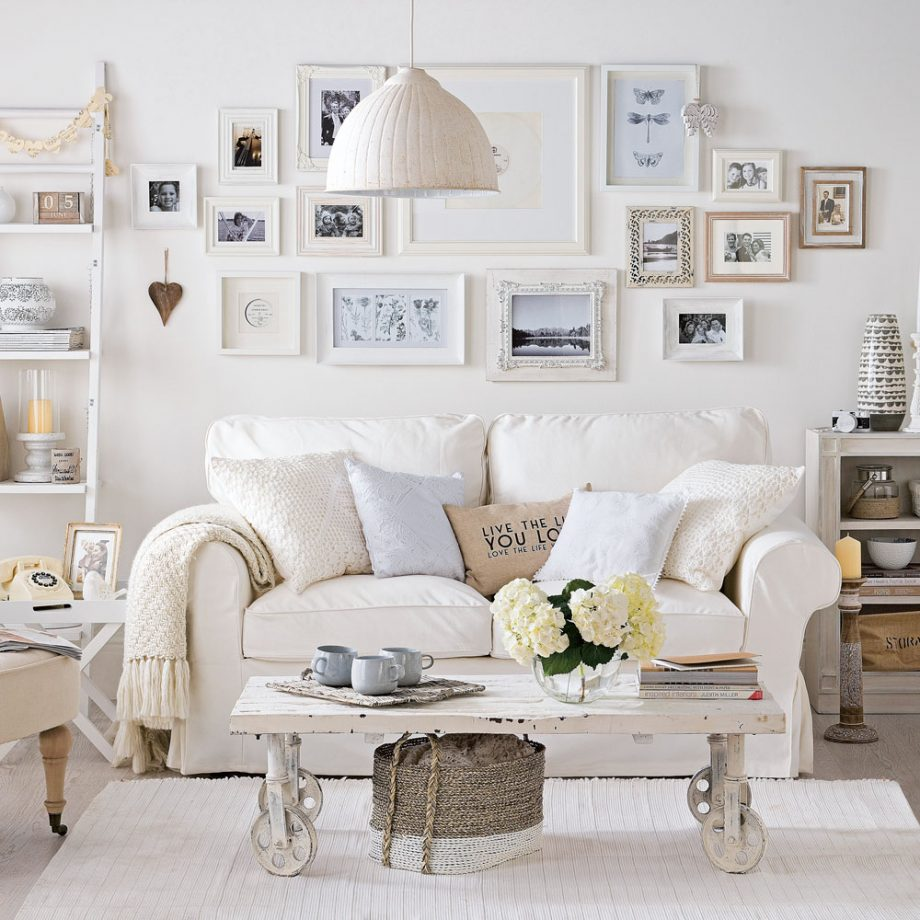 Wall art with framed family pictures.  Source: idealhome.co.uk
