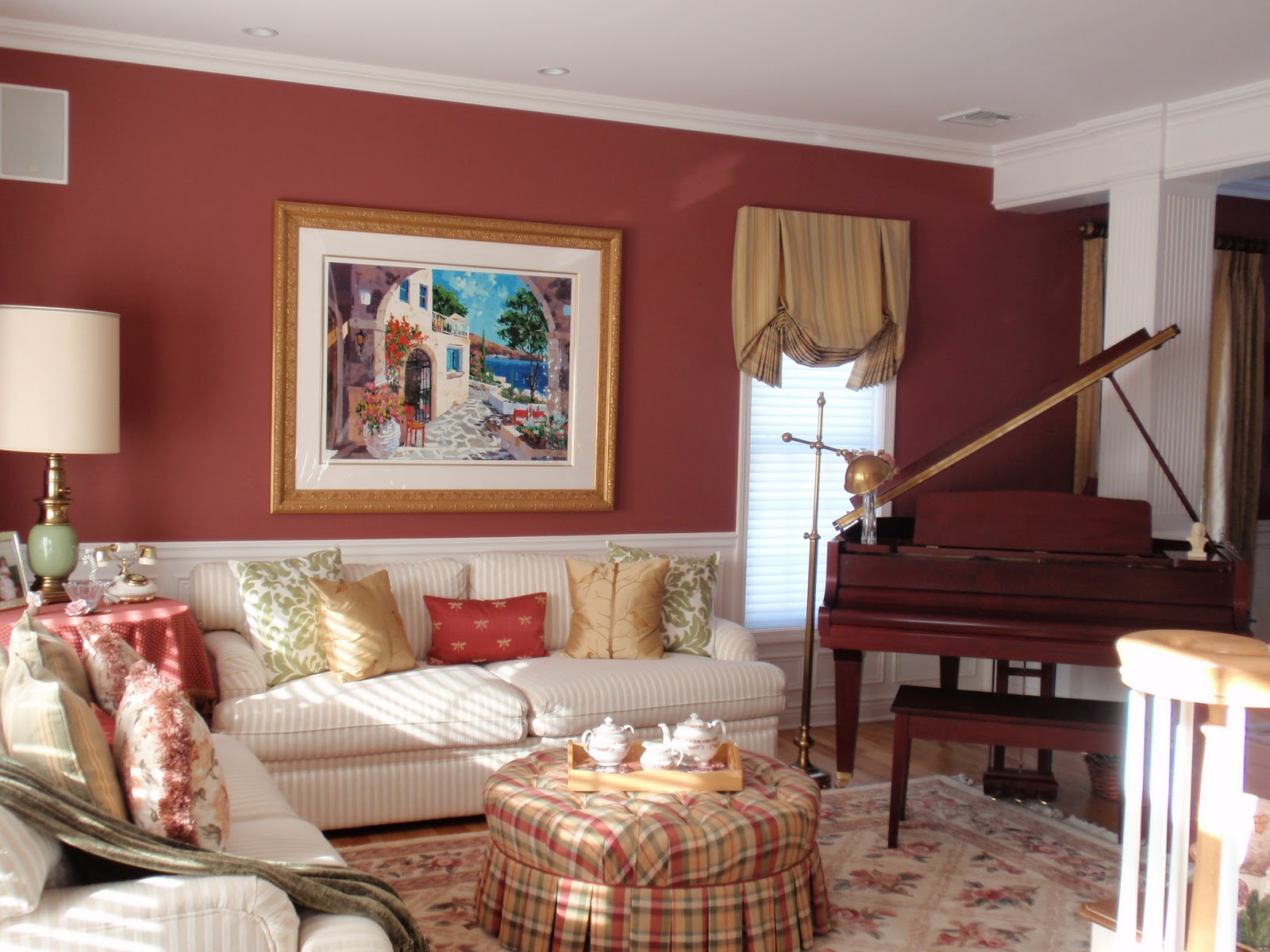 Vintage living room with striped sectional sofa.  Source: PrinceGeorges.com