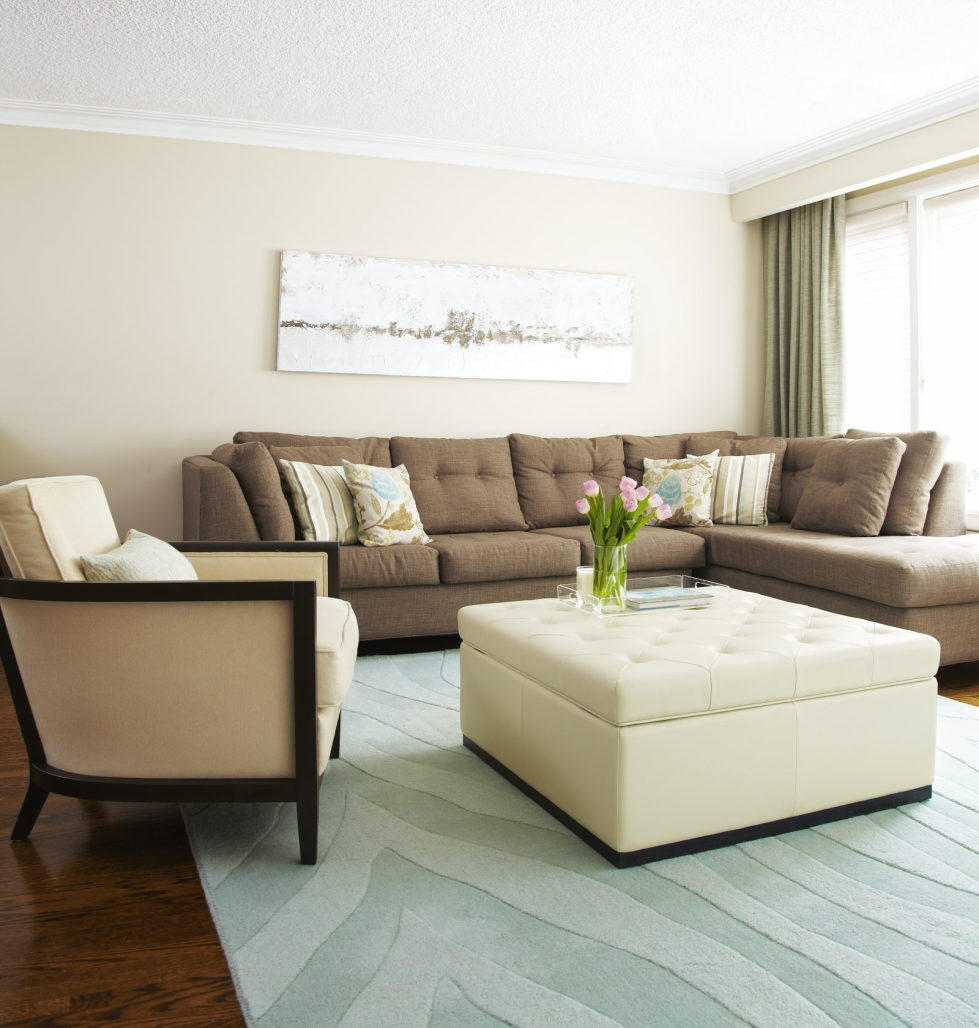 Living room with sofa set and multifunctional stool.  Source: decoist.com