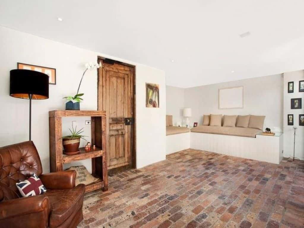 Brick living room floor.  Source: Pinterest