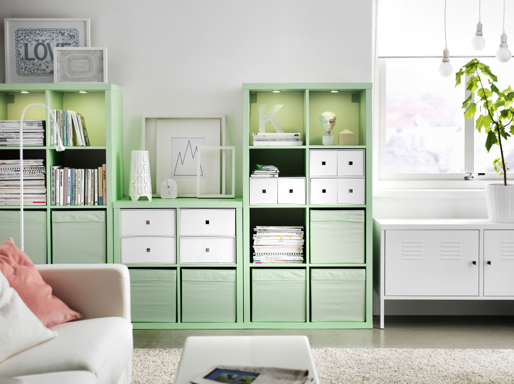 Living room with mint green storage space.  Source: homedit.com