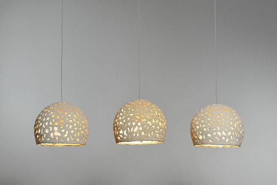 3 ceramic pendant lights.  CUMNBLC blanket