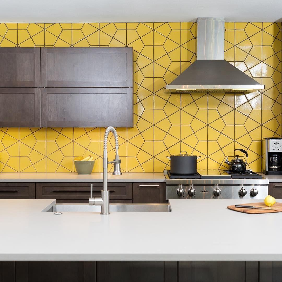 Stylish, yellow kitchen splashback