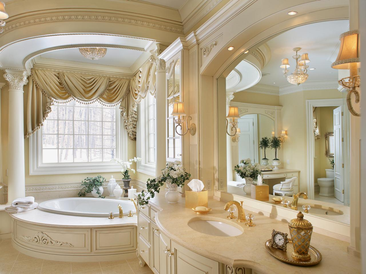 Spacious bathroom in white and gold