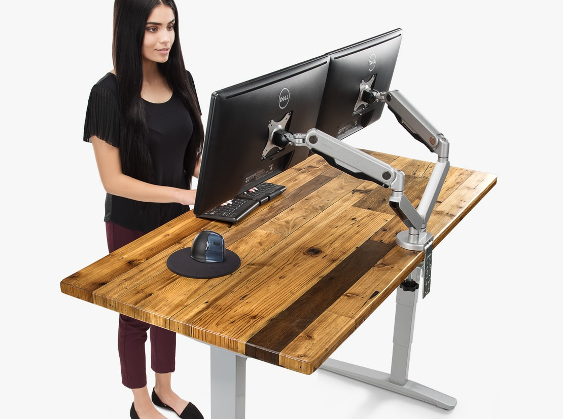 a completely height-adjustable desk with a desk made of reclaimed wood BEOZTSG