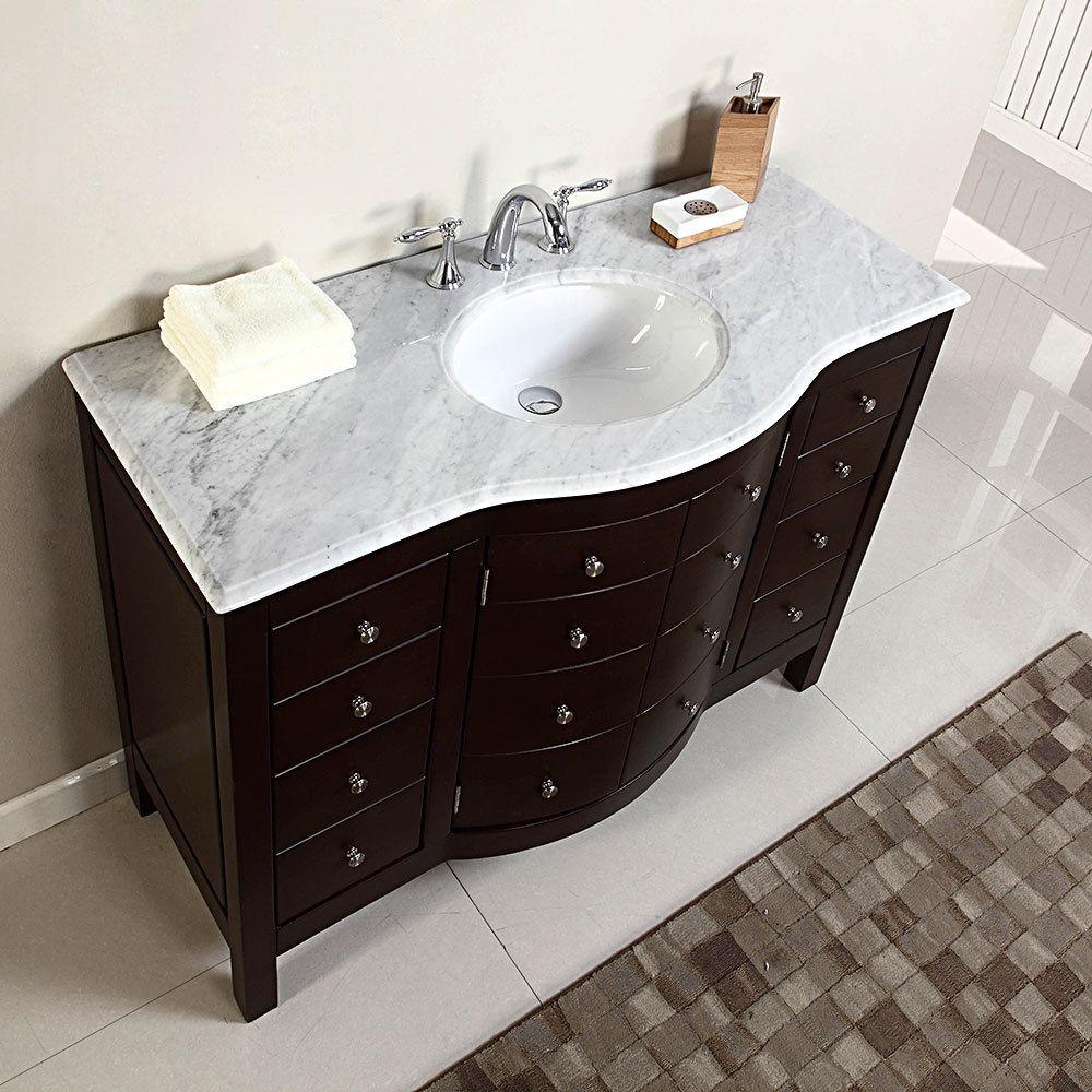 Washbasin cabinets with marble tops above our TWNKIHL washbasins