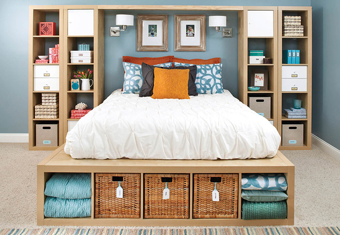 Bedroom storage ideas bed surrounded by shelves ZMLSXMV