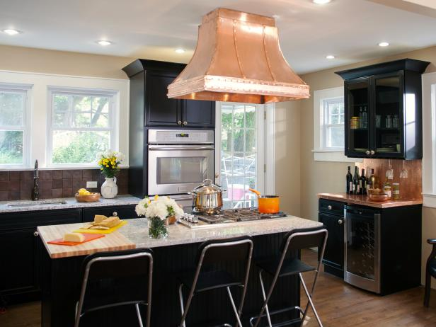 black kitchen cabinets transition kitchen with black cabinets & copper extractor hood XFKXLSF