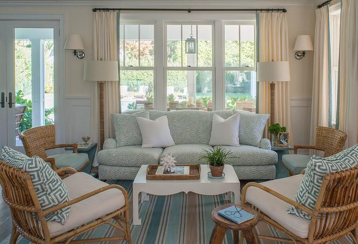 The blue cottage living room has a blue roll-up arm sofa that comes with.