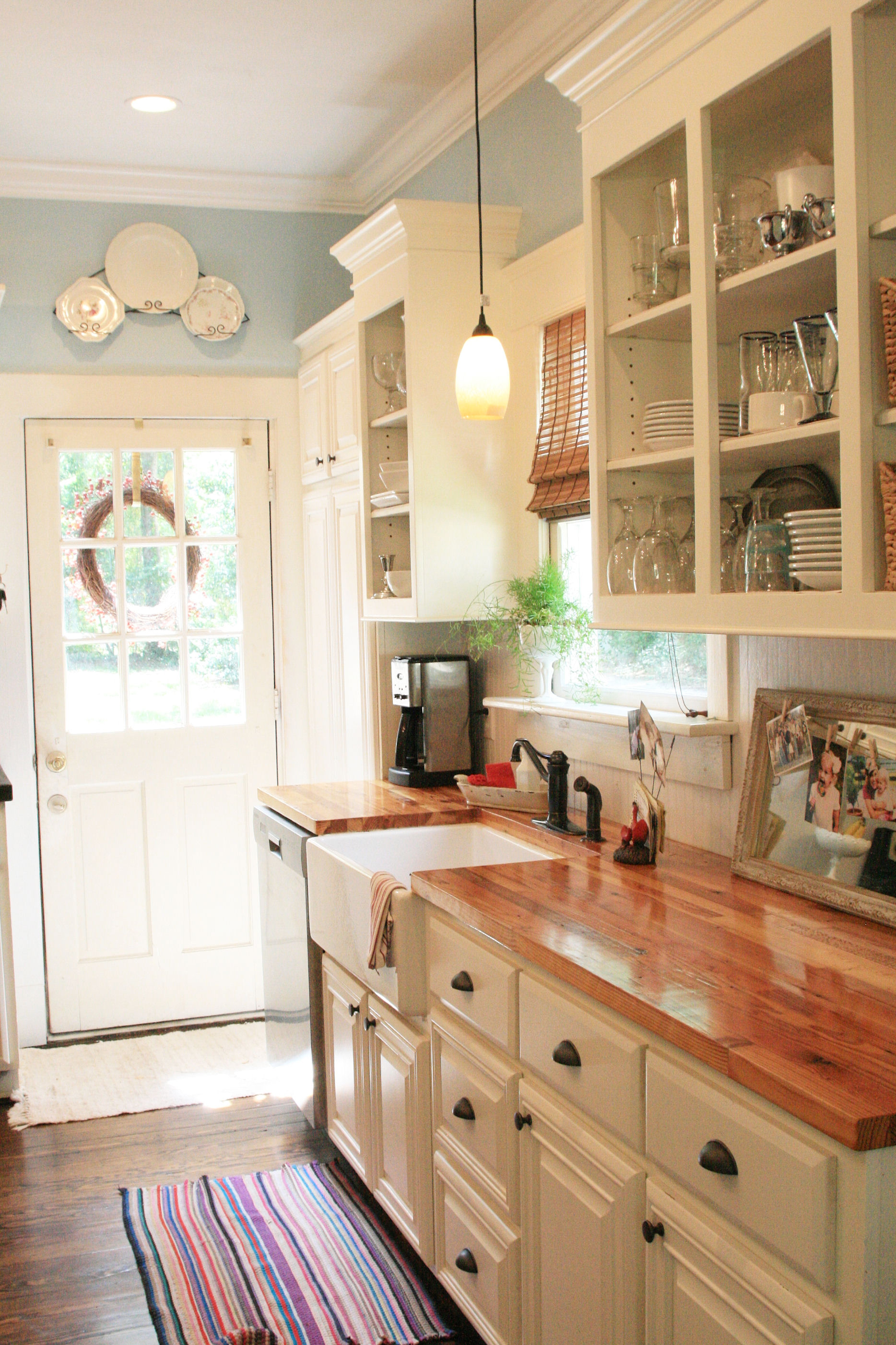 Country kitchen wood countertops add warmth to a clean white kitchen MUJYAQE