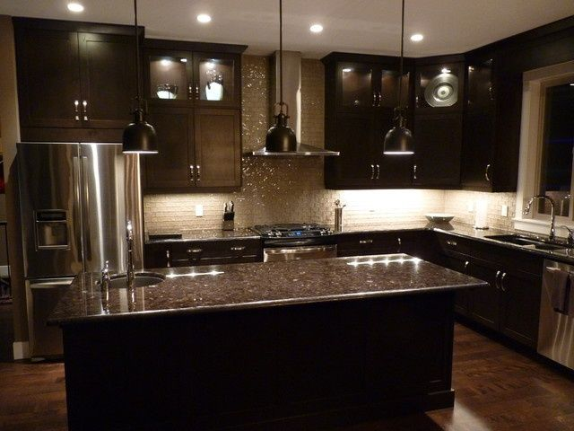 Cool interesting and functional design ideas for dark kitchen cabinets.