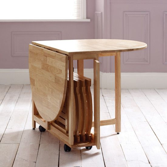 folding dining table on wheels + folding chairs that fit in the center.  PTVSVYK