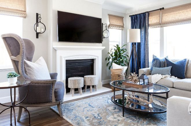 Living room color scheme in blue, white, gray and beige.     Beige.