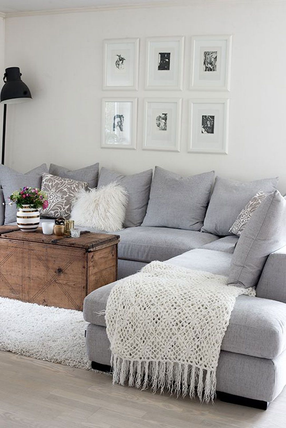 gray couch that makes it cozy and it could just be a throw or GDNLRYF.  be