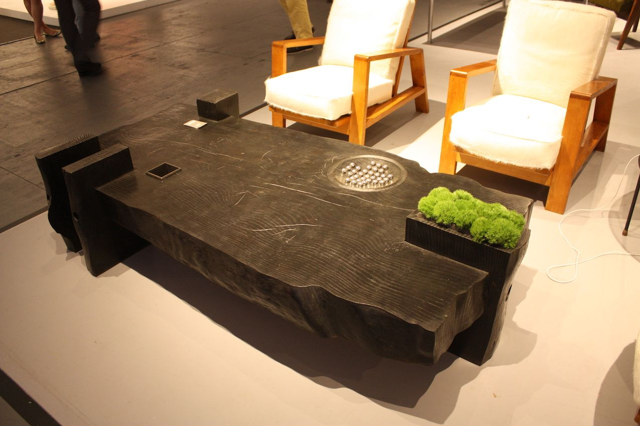Modern Coffee Tables This sturdy table includes a plant pot and a game detail for interest.  PCBLZVX