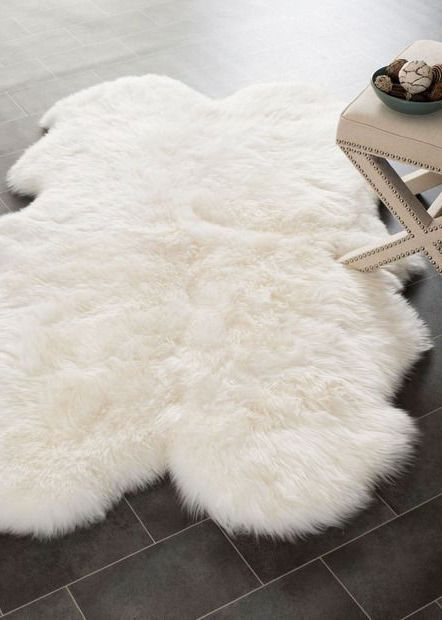 obsessed with this white sheepskin rug that goes perfectly with an FCYZDJC