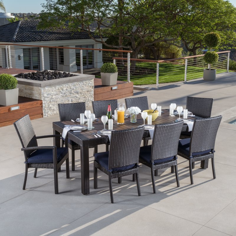 Outdoor dining sets Evansville 9-piece outdoor dining set with pillows MGWSVIJ