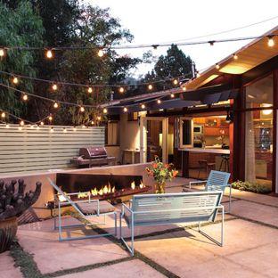 Patio lighting example for a 1960s backyard patio design in Santa Barbara XQJTAML