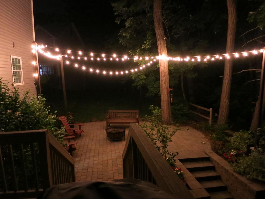 Image of patio lighting with OKQLFAE planters