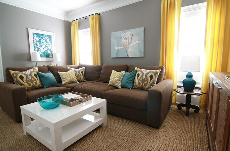 gray walls brown couch - Google Search    Living room with a brown couch.