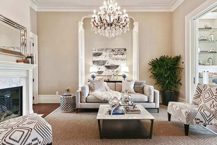 traditional formal living room with chandelier and fireplace QGOQJLS