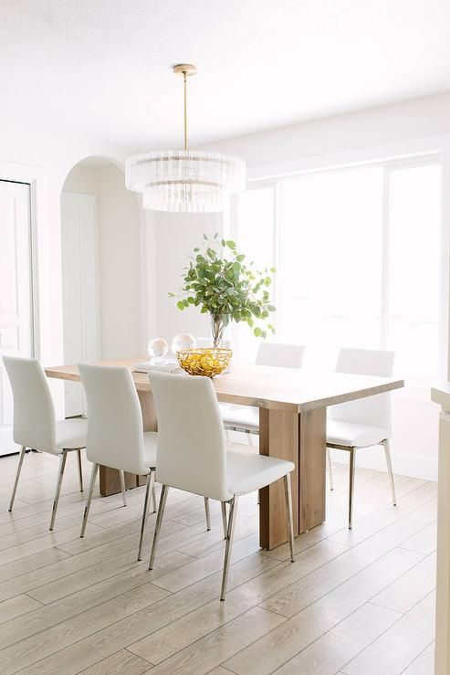 white dining chairs Kiste & Barrel Monarch natural solid walnut dining table RGMNBHZ