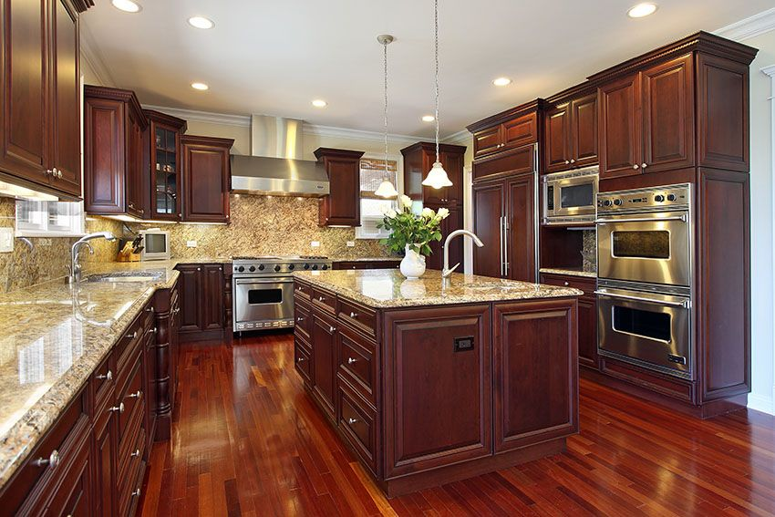 Wooden cabinets Kitchen in luxury house with dark cherry wood cabinets, wooden floors and VKDPVOG