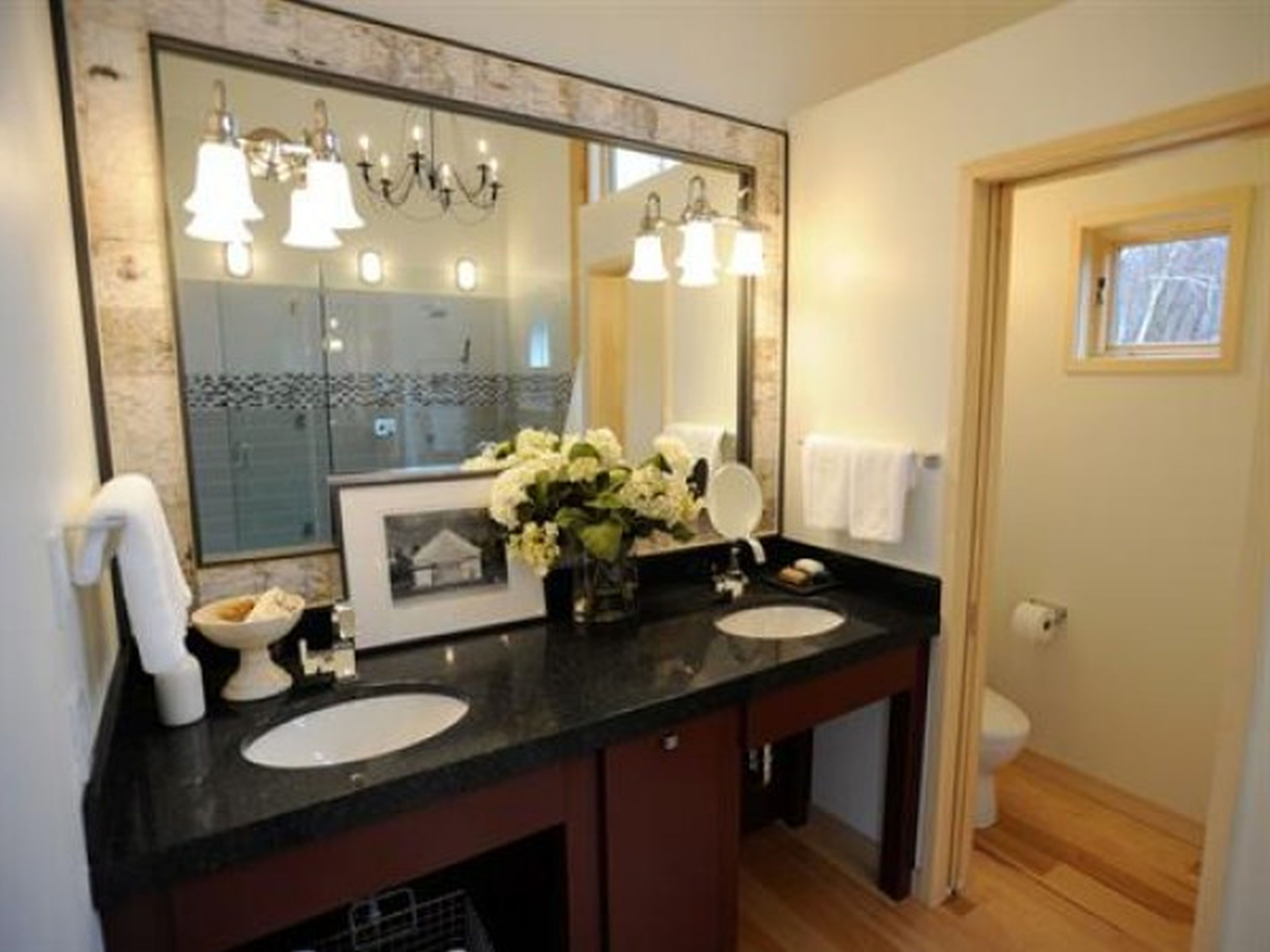 ideas for wooden bathroom furniture.  dark brown wooden washbasin with black granite top by GDSWINE