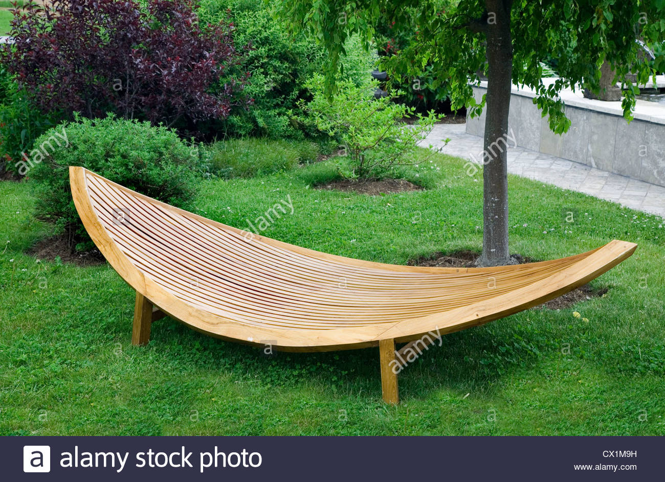 Garden furniture made of wood Simple modern garden furniture made of wood and lacquered.  - Stock Image EQXCYZK